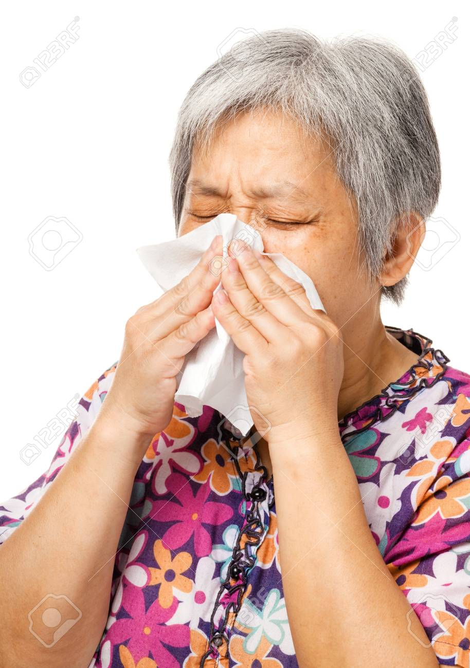 Sneezing mature asian woman Stock Photo - 21353038