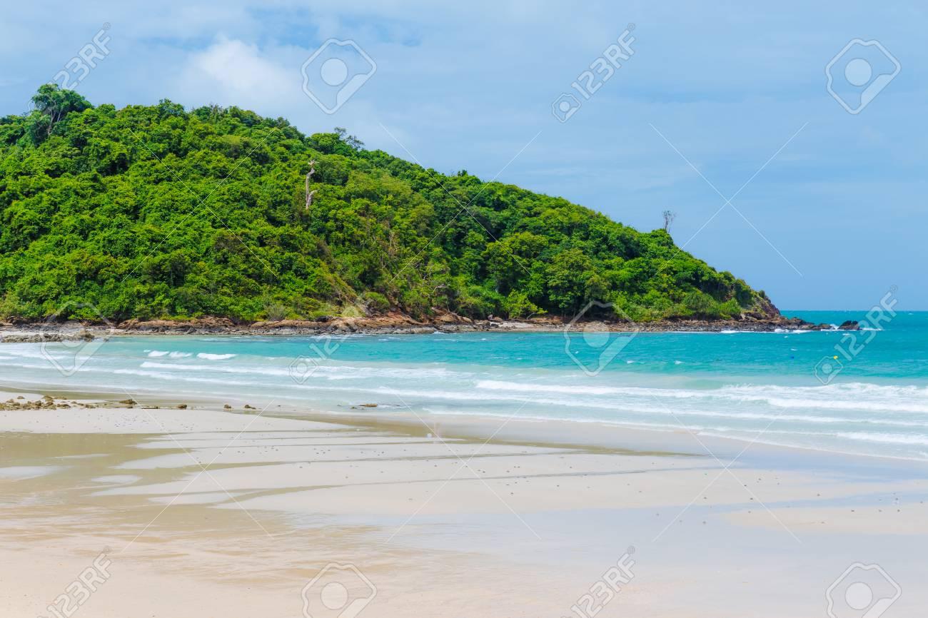 Tropical beach and small island - 22523089