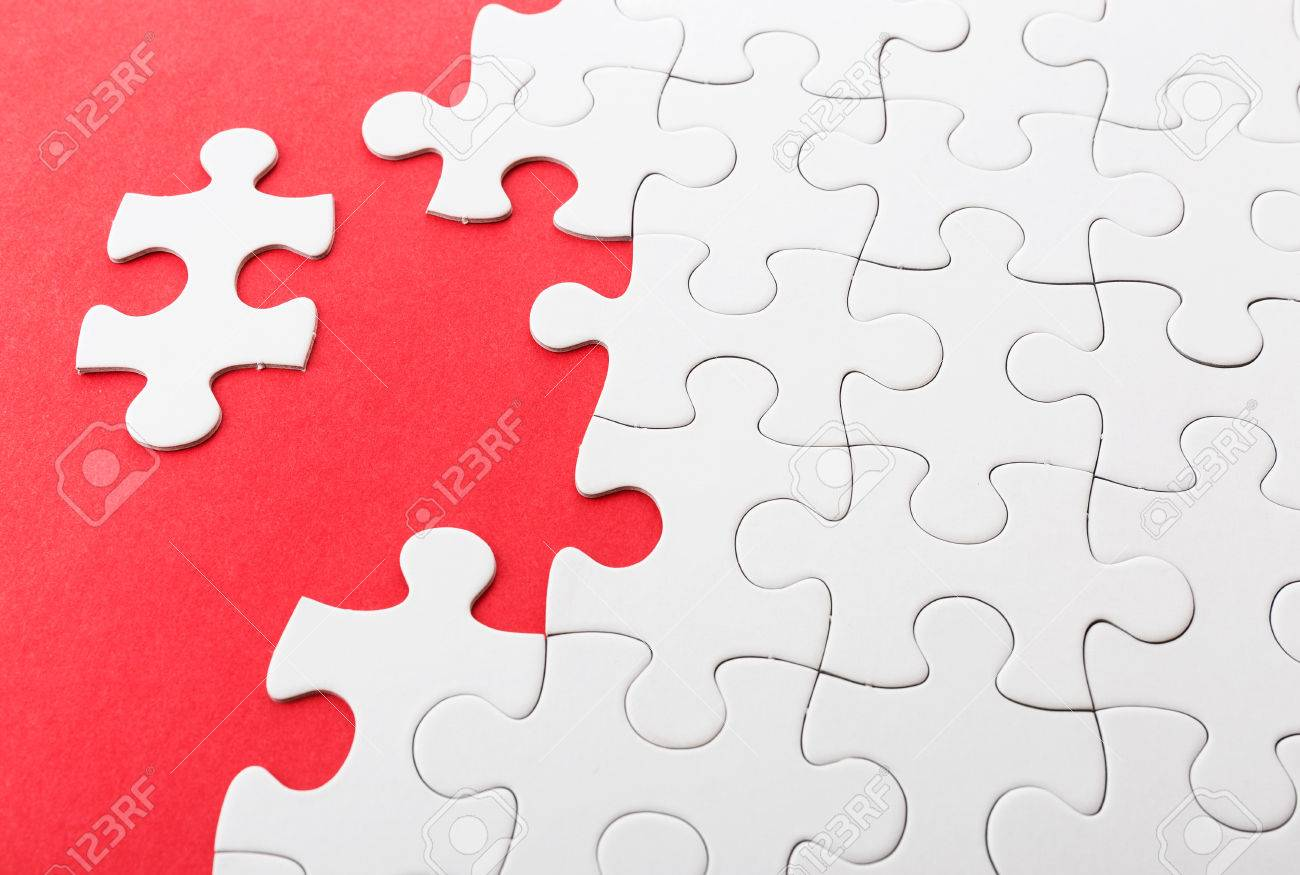 Incomplete Puzzle With Missing Pieces Stock Photo