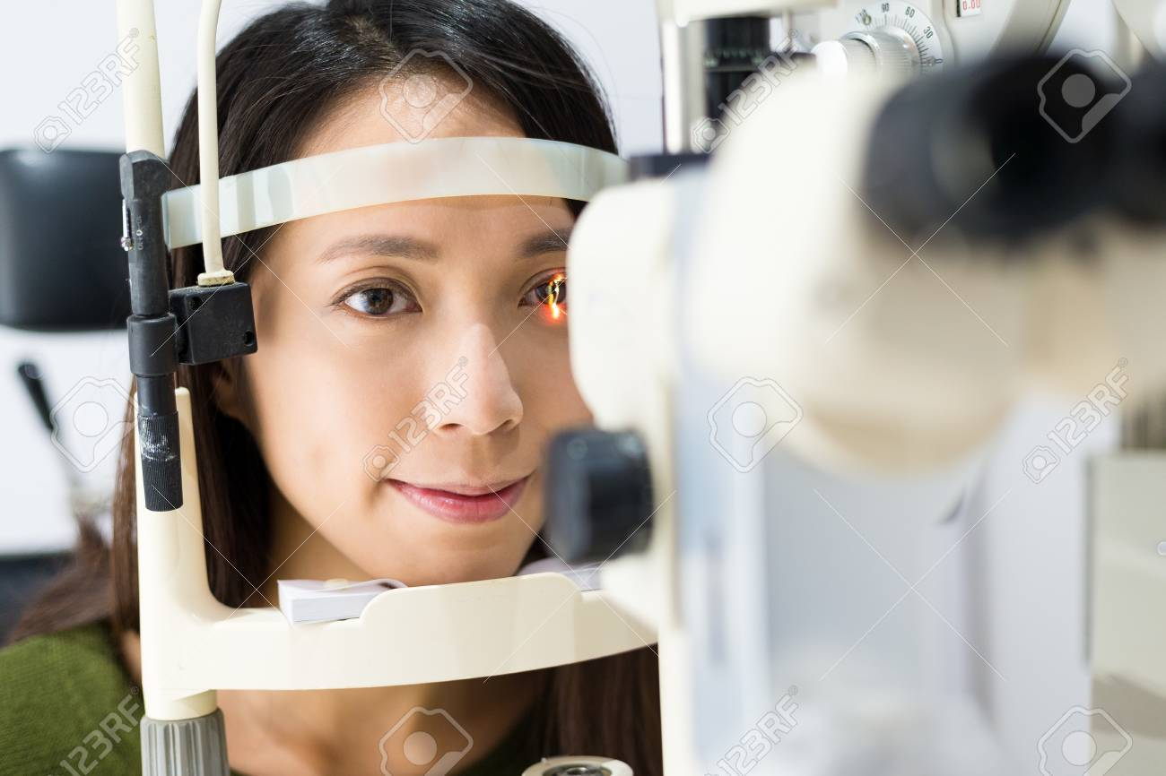 6a479e65afc0 Stock Photo - Young woman is having eye exam