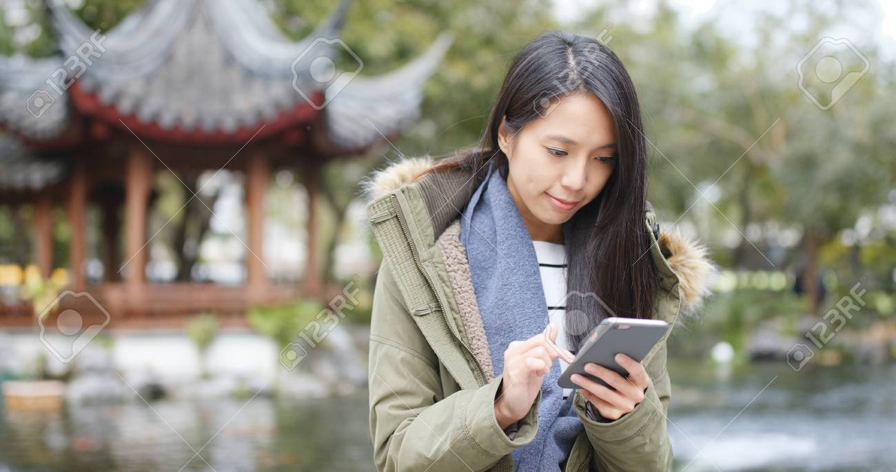 Young woman using mobile phone, sending sms and reply group chat