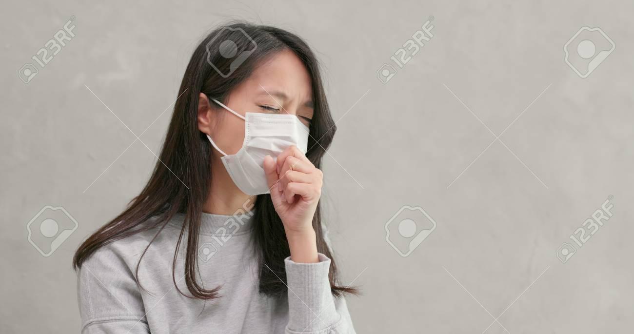 Woman wearing mask and feeling sick - 111840308