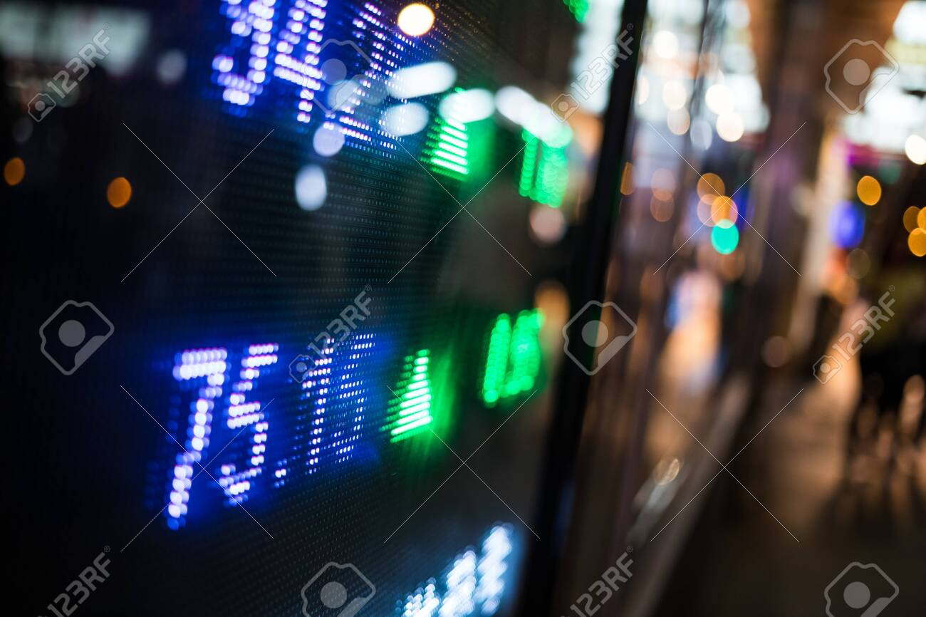 Display of Stock market quotes in city at night