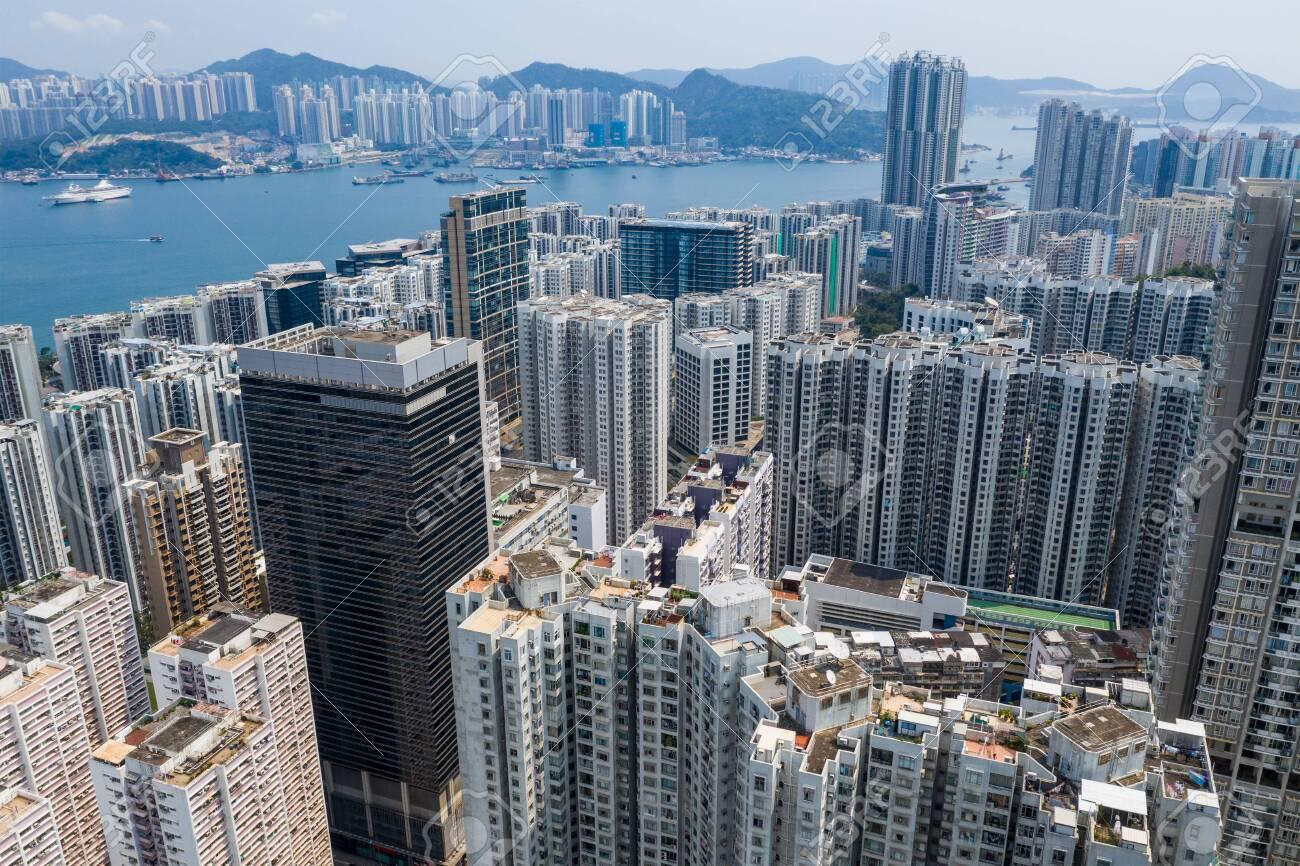 Tai Koo, Hong Kong 19 March 2019: Drone fly over Hong Kong city - 122193342