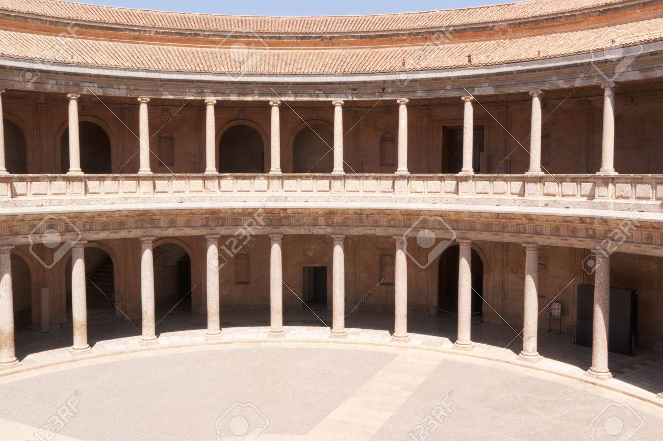 Circular Patio Of The Palace Of Charles V In Granada. The Construction Of  This Palace
