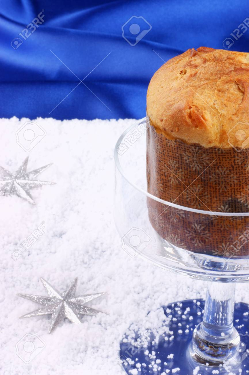 Christmas Composition Over A Bright Blue Background: Panettone ...