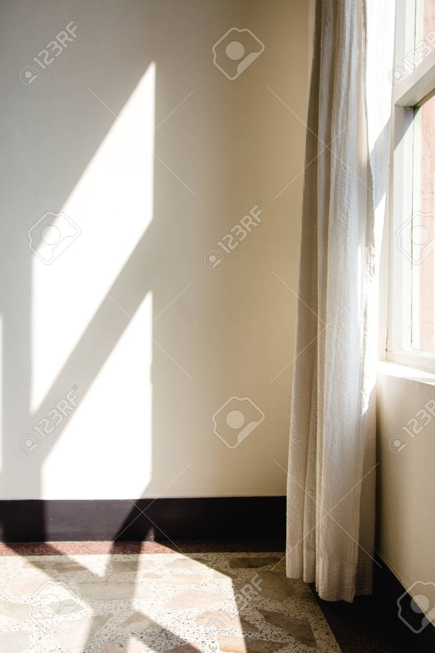 Early morning light streaming through a window and onto a floor