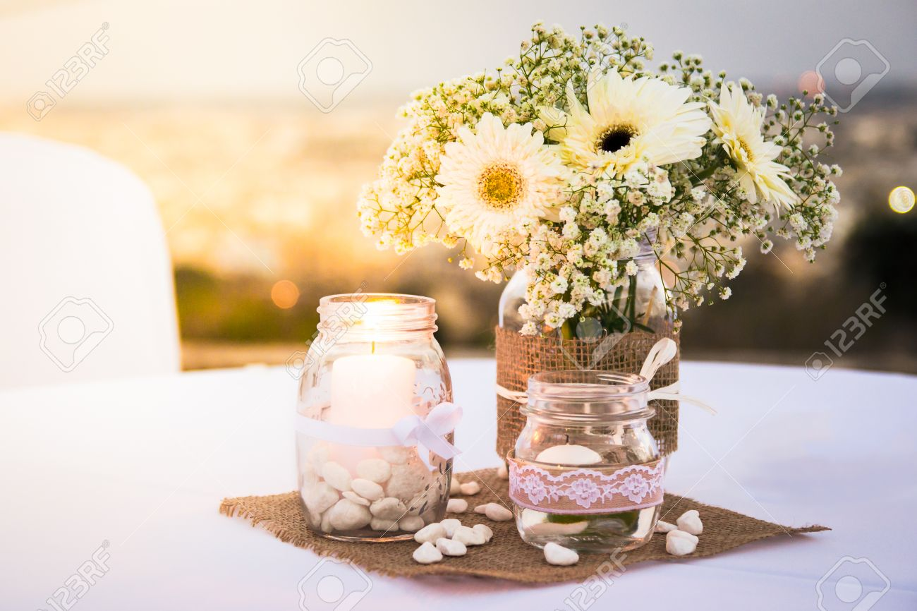 Pretty White Wedding Table Decorations With Flowers Candles Stock Photo Picture And Royalty Free Image Image 77825754