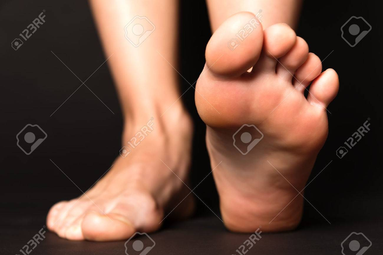 Foot stapping isolated on black - 41664937