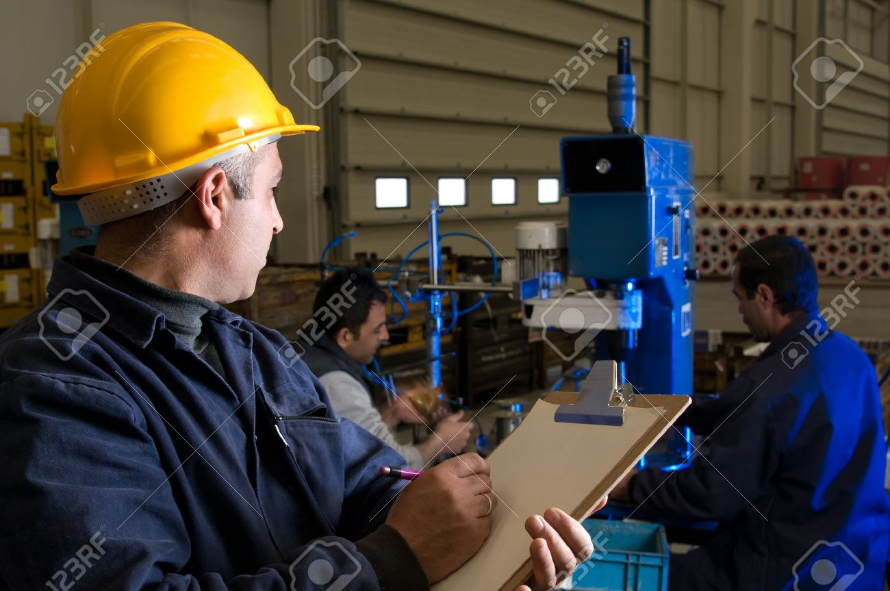 Inspector controlling workers at wood factory Stock Photo - 14287466