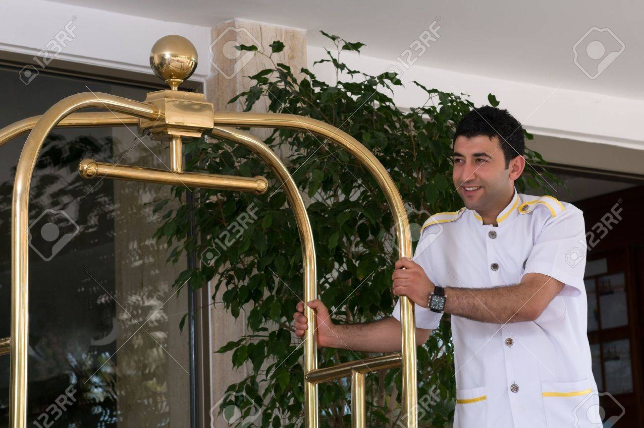 Bellboy with luggage cart Stock Photo - 14426771