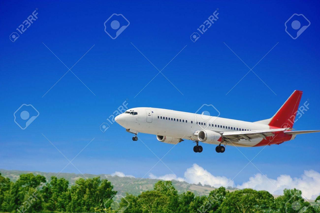 Large jet passenger airplane approaching for landing Stock Photo - 9928851