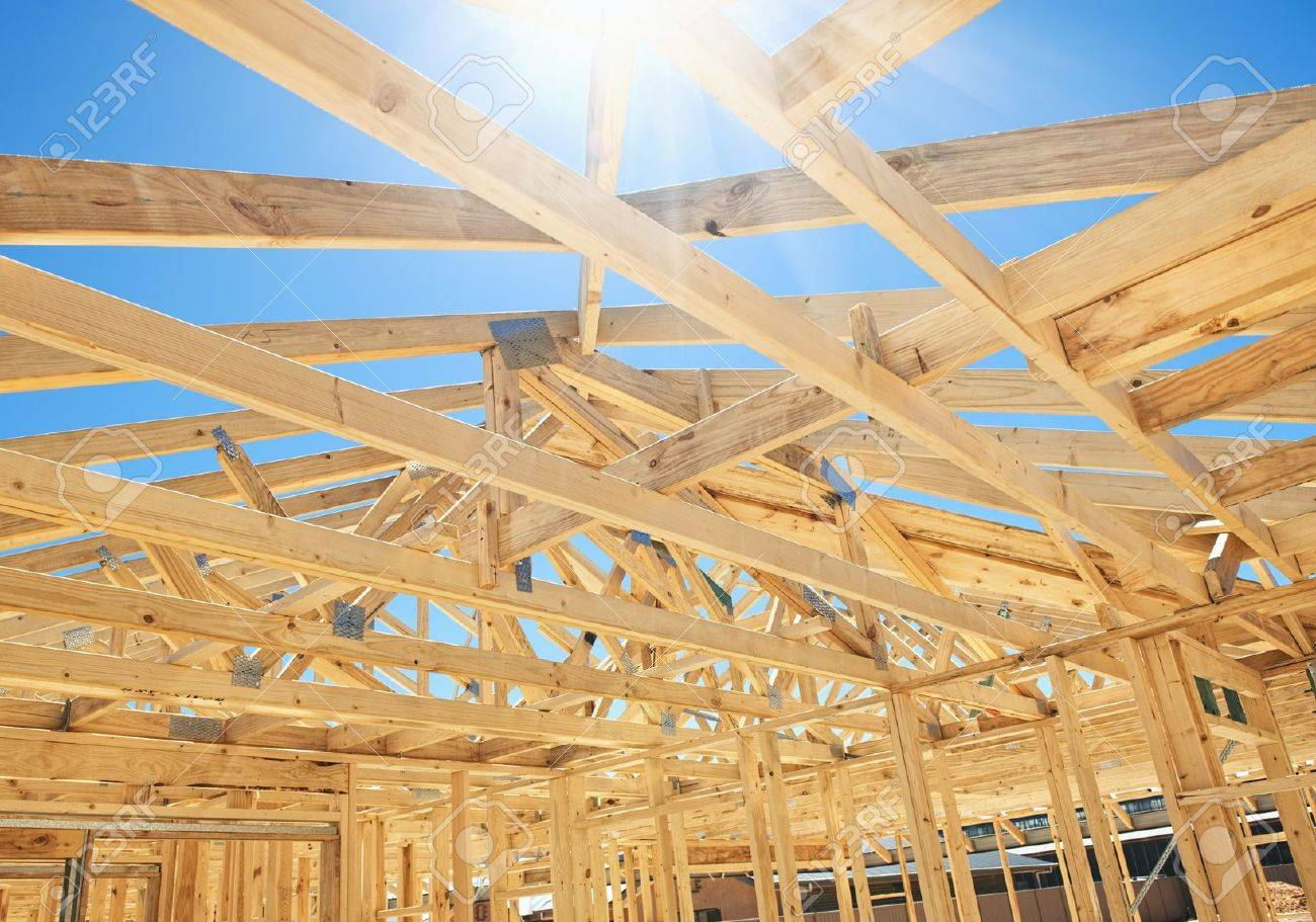 new residential construction home framing with roof view stock photo 12527247