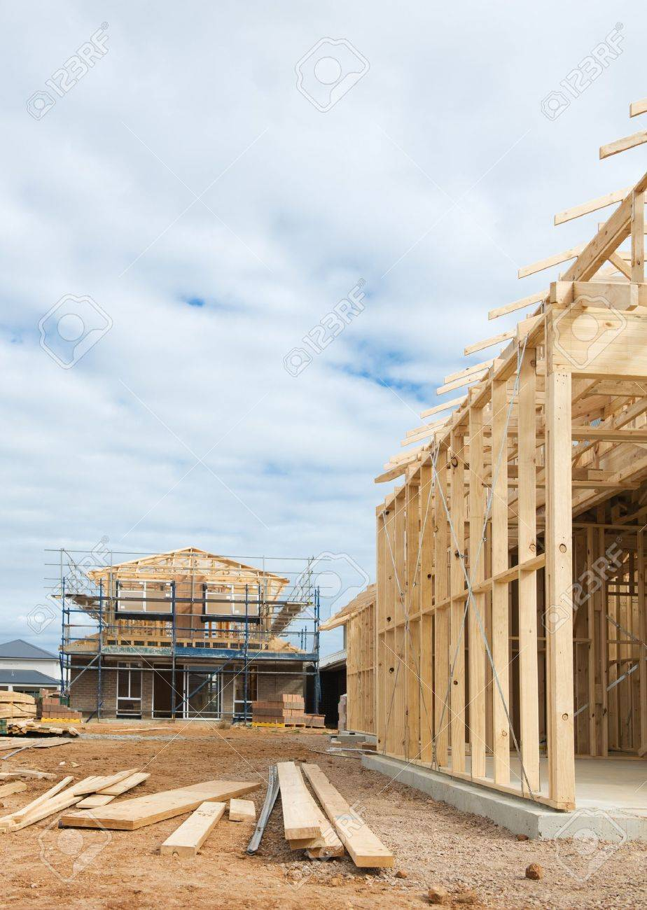New residential construction home wooden framing against a blue sky Stock Photo - 12527428