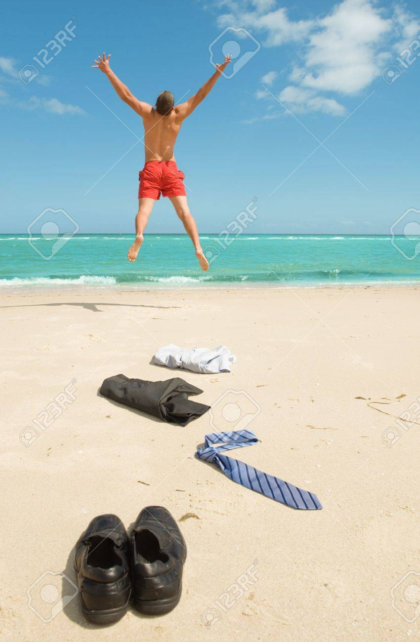 young businessman jumping on the beach after a big deal Stock Photo - 12955221