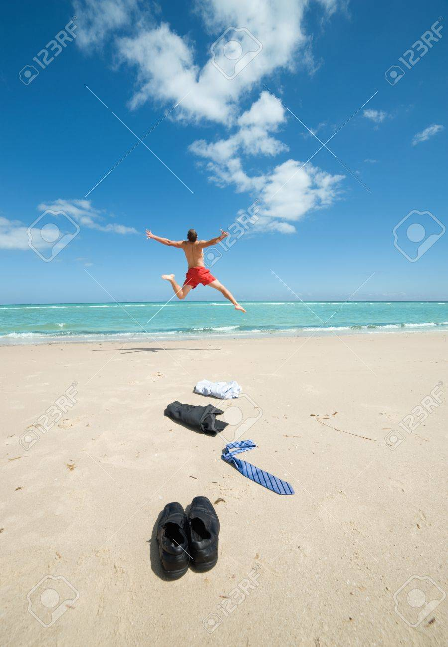 young businessman jumping on the beach after a big deal Stock Photo - 13236187