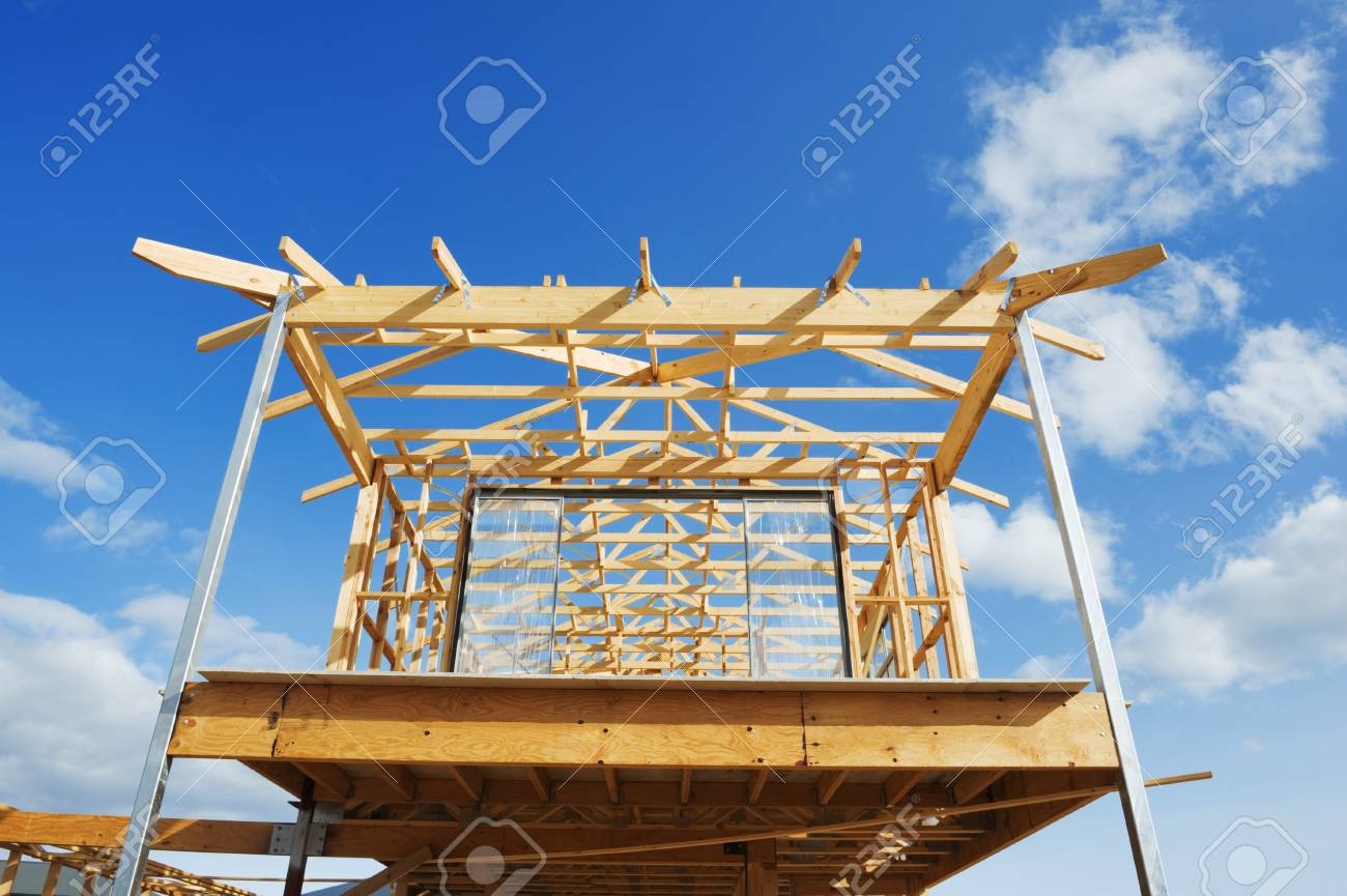 New residential construction home wooden framing against a blue sky Stock Photo - 13620754