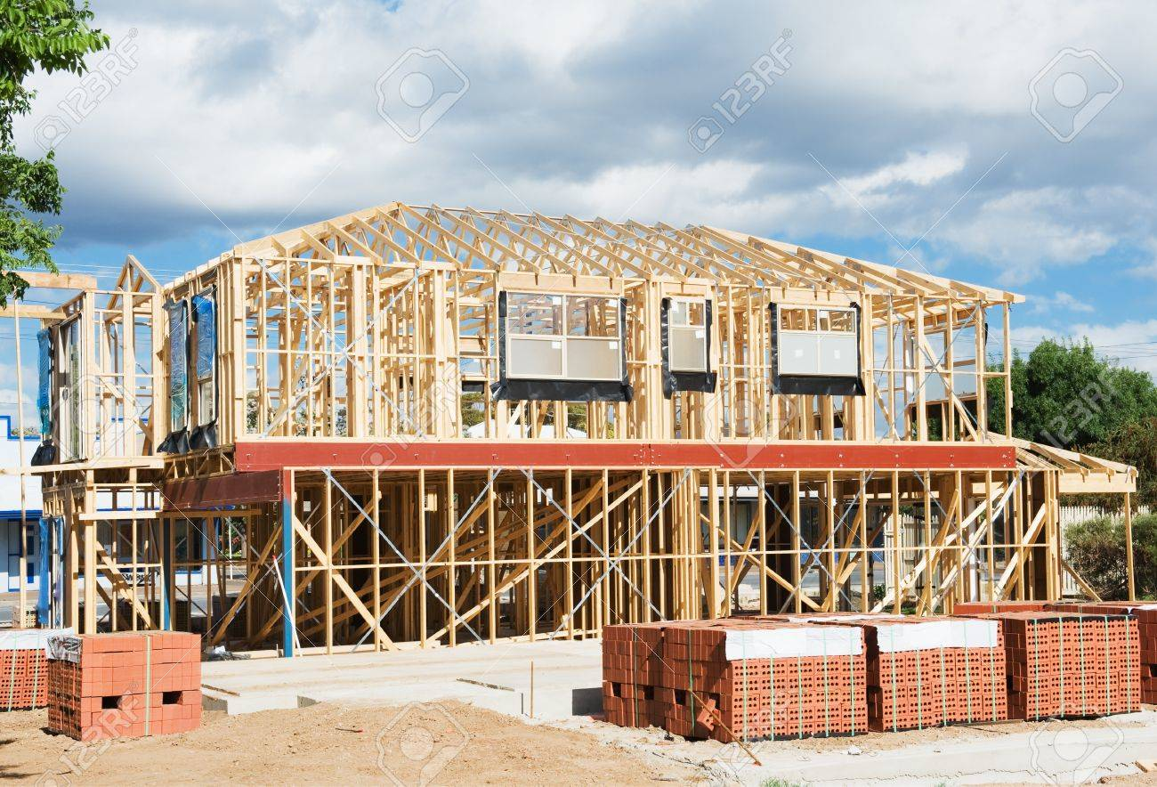 New residential construction home wooden framing against a blue sky Stock Photo - 14654122