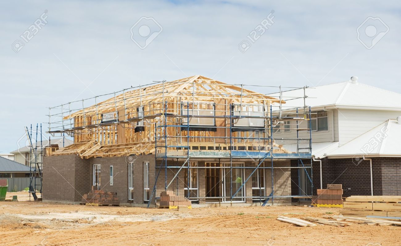 High Quality Construction Site With The House In Scaffolding Against A Blue Sky Stock  Photo   16113280