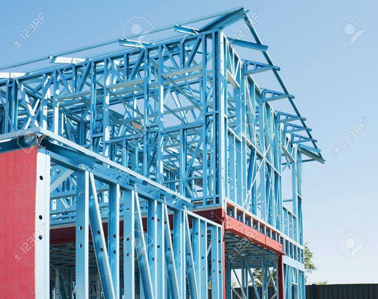 New residential construction home metal framing against a blue sky - 18465156