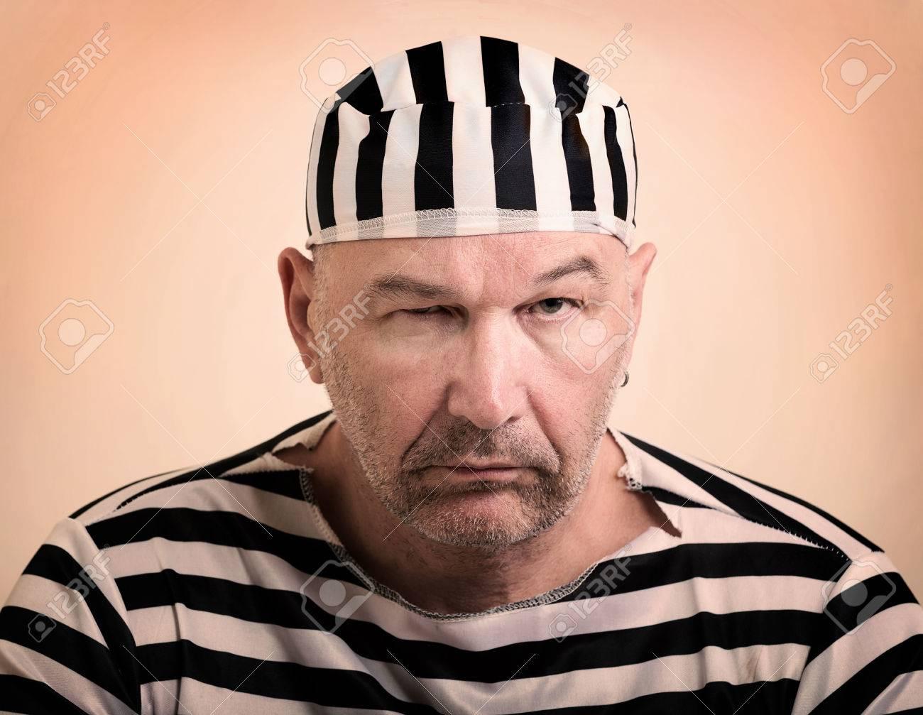 portrait of a man prisoner in prison garb Stock Photo - 27469055