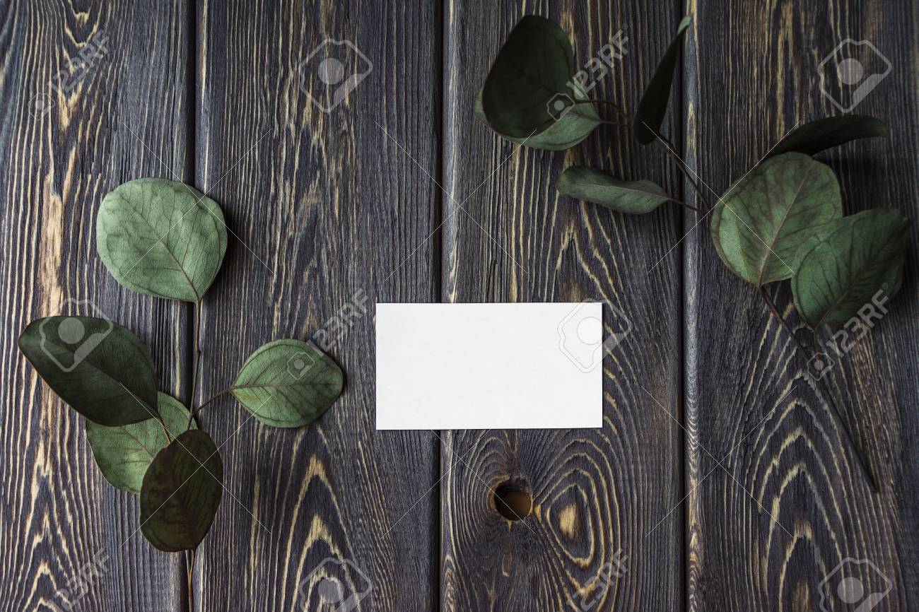 Creative layout made of leaves on old wooden table with business creative layout made of leaves on old wooden table with business card flat lay reheart Image collections