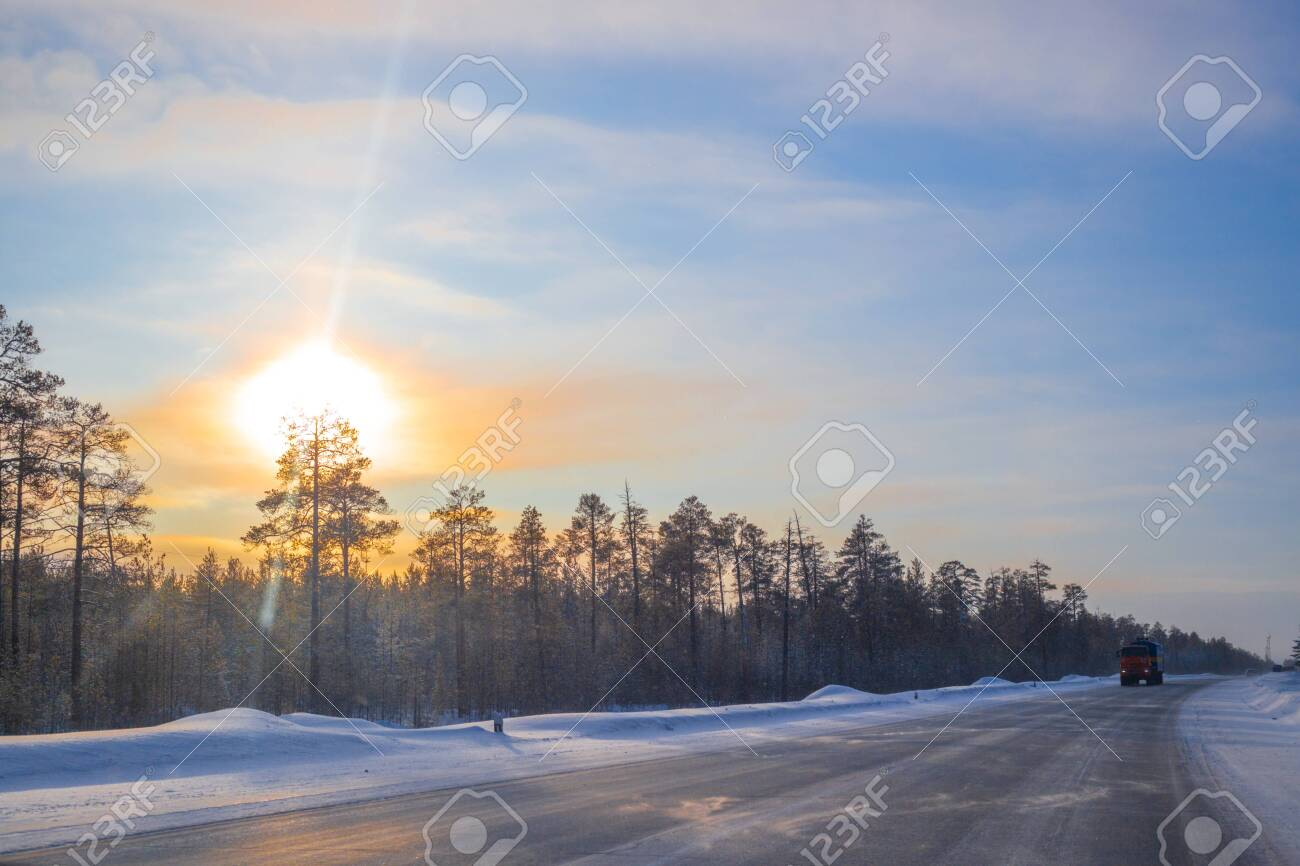 cars ride on a winter road on a sunny day - 139273526