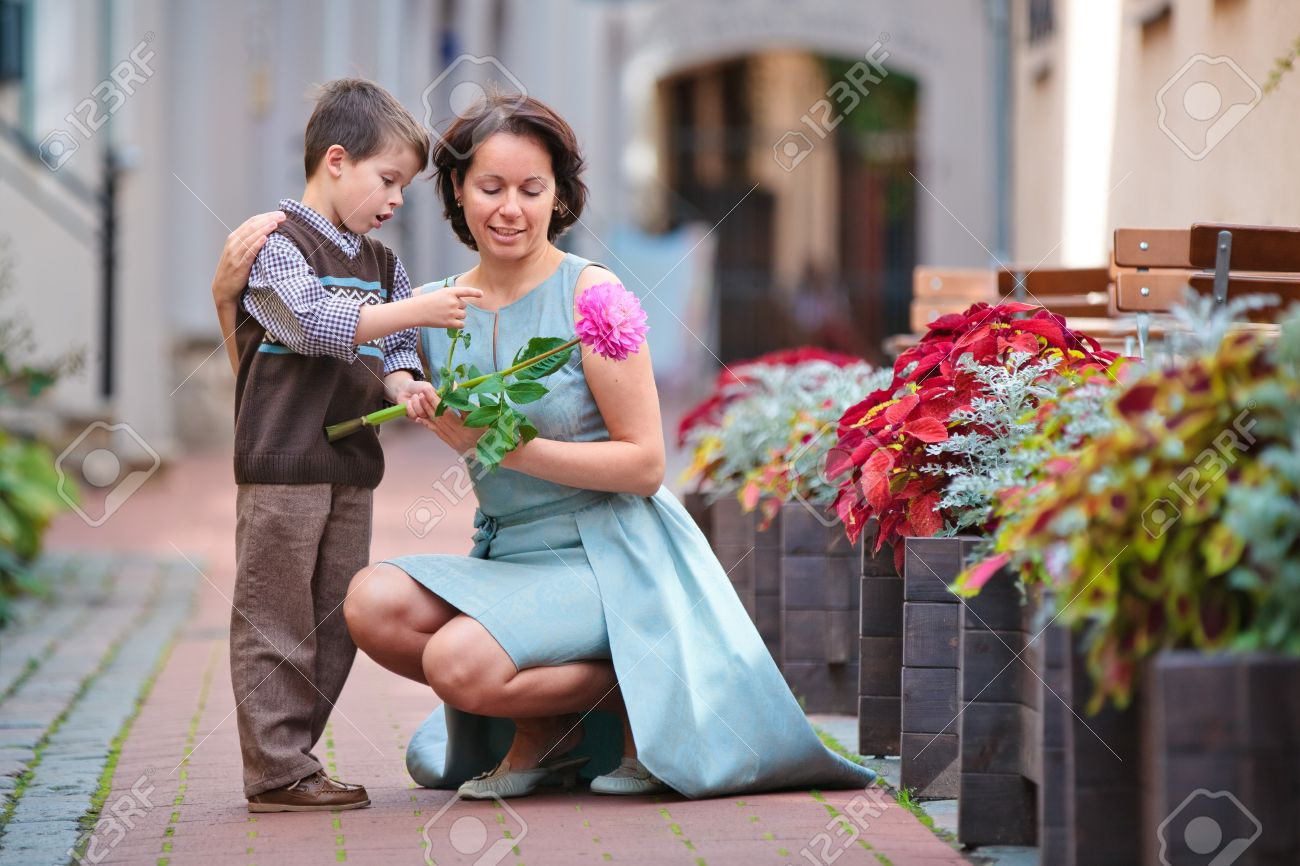 Little boy giving flower to his mom on mother s day Stock Photo - 18263279