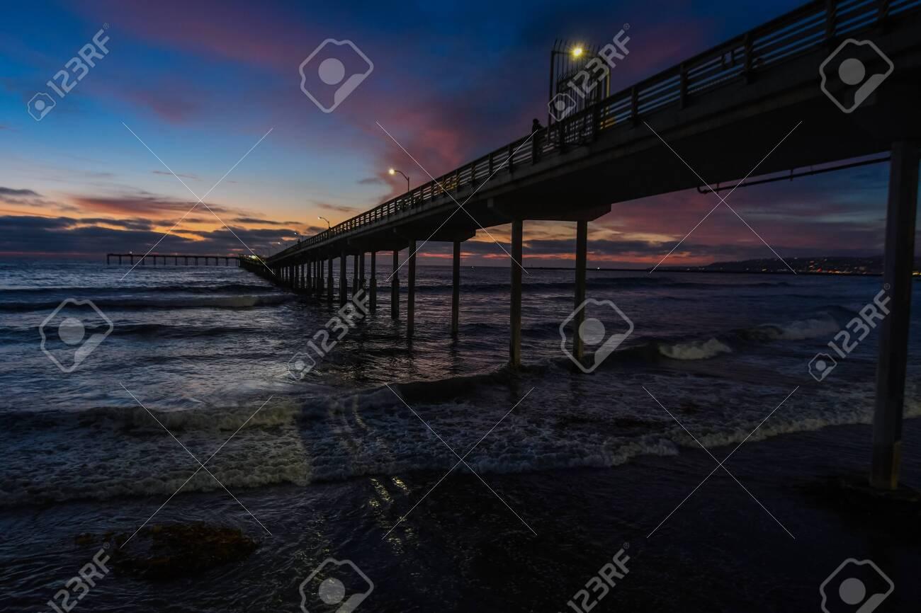 Sunset at Ocean Beach Pier in San Diego California, USA - 128100496