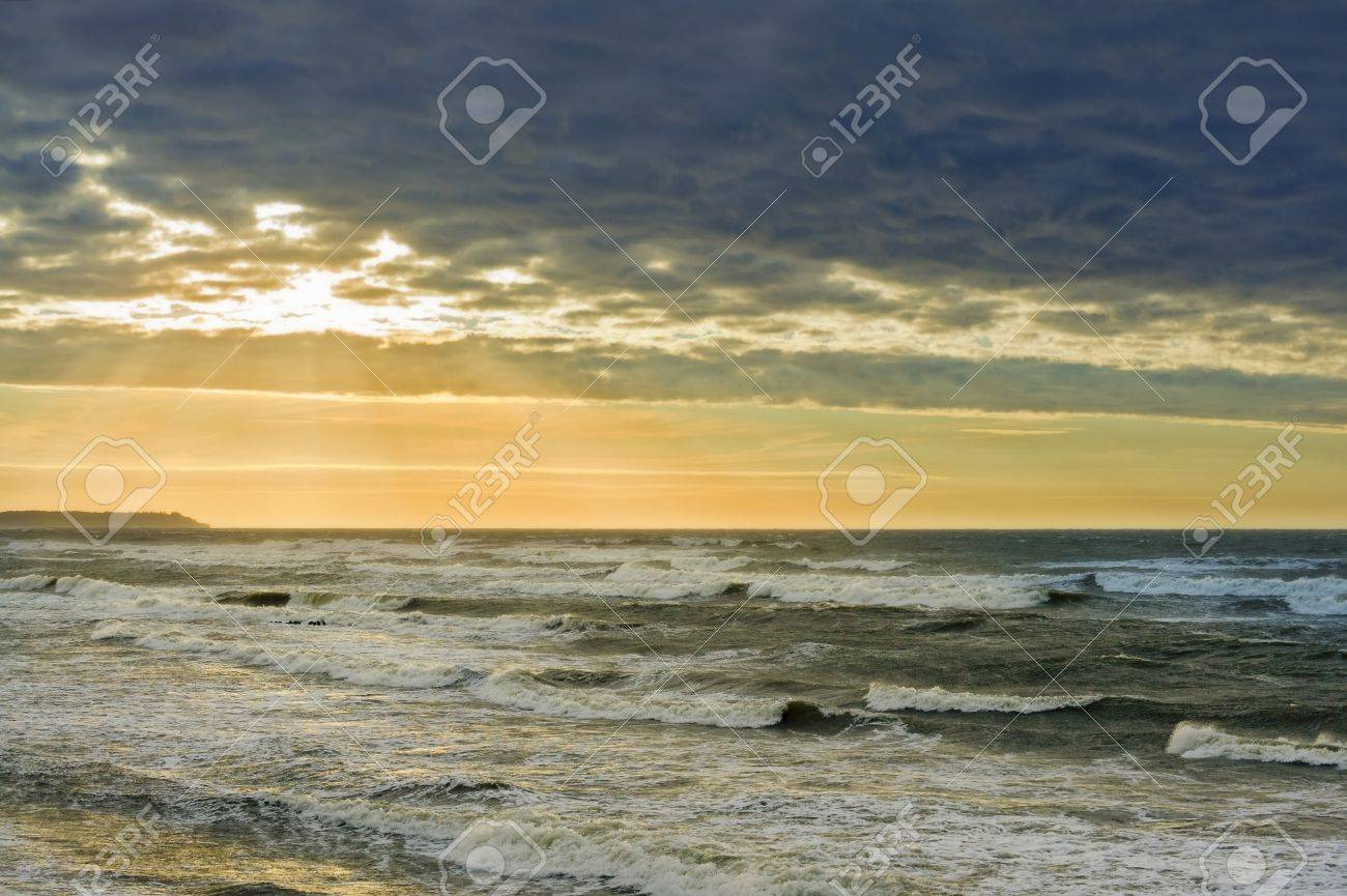 The evening on the banks of the storm sea Stock Photo - 16271660