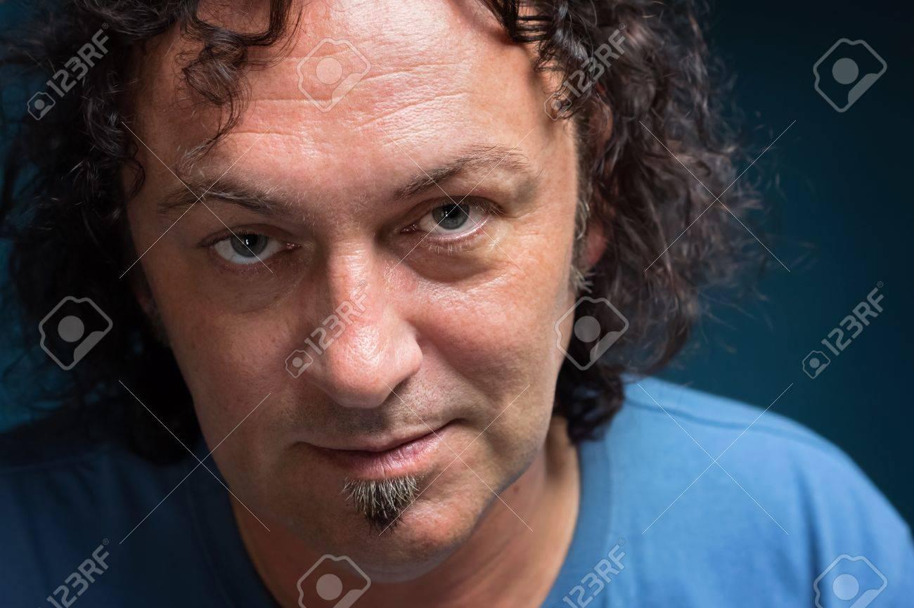 men with dark curly hair