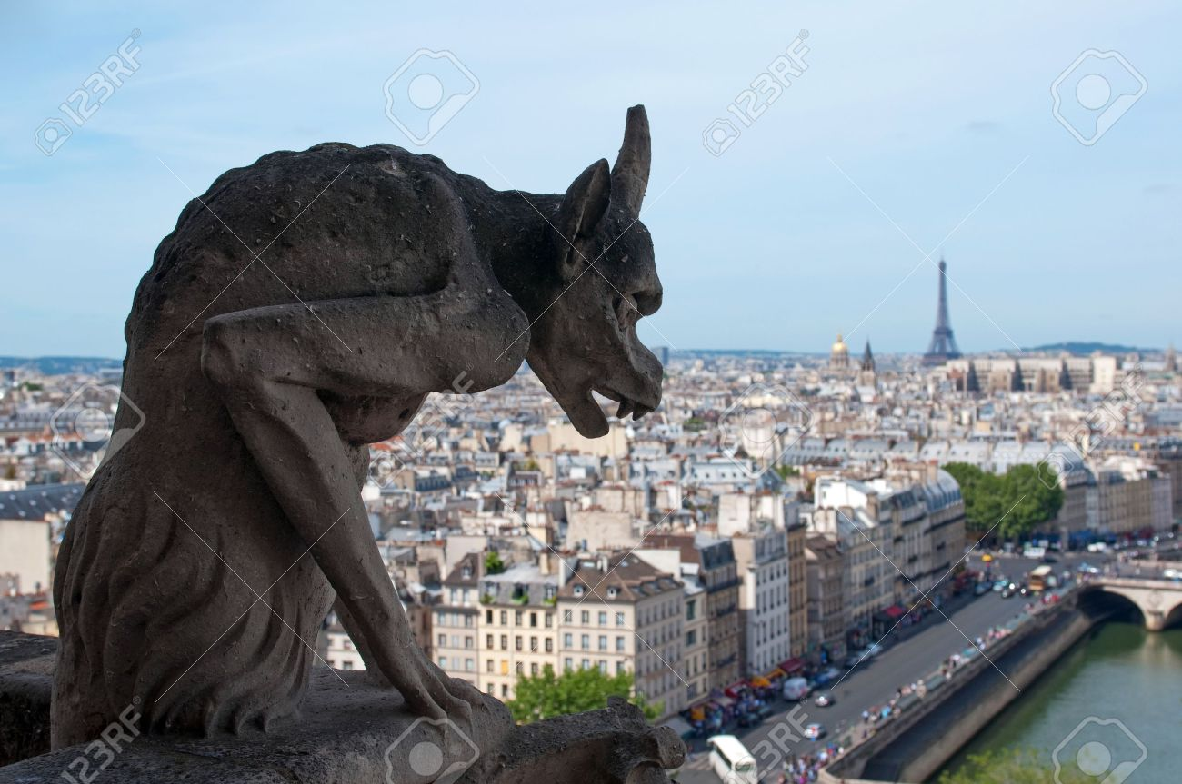 Famous Chimera (demon shape) overlooking the Eiffel Tower from Notre Dame of Paris - 9804101