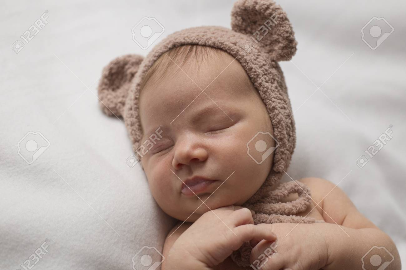 Portrait of a sleeping newborn child in a hat with ears Stock Photo -  101662345 f4bdcd245830