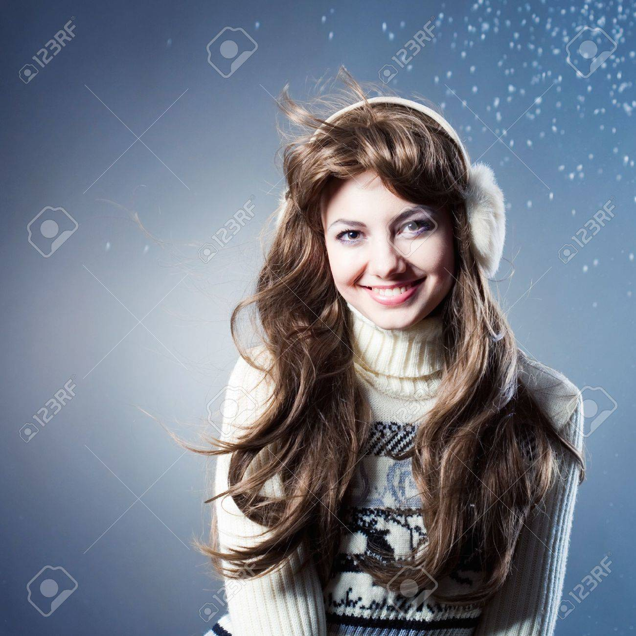 young beautiful rejoices to snow stock photo picture and