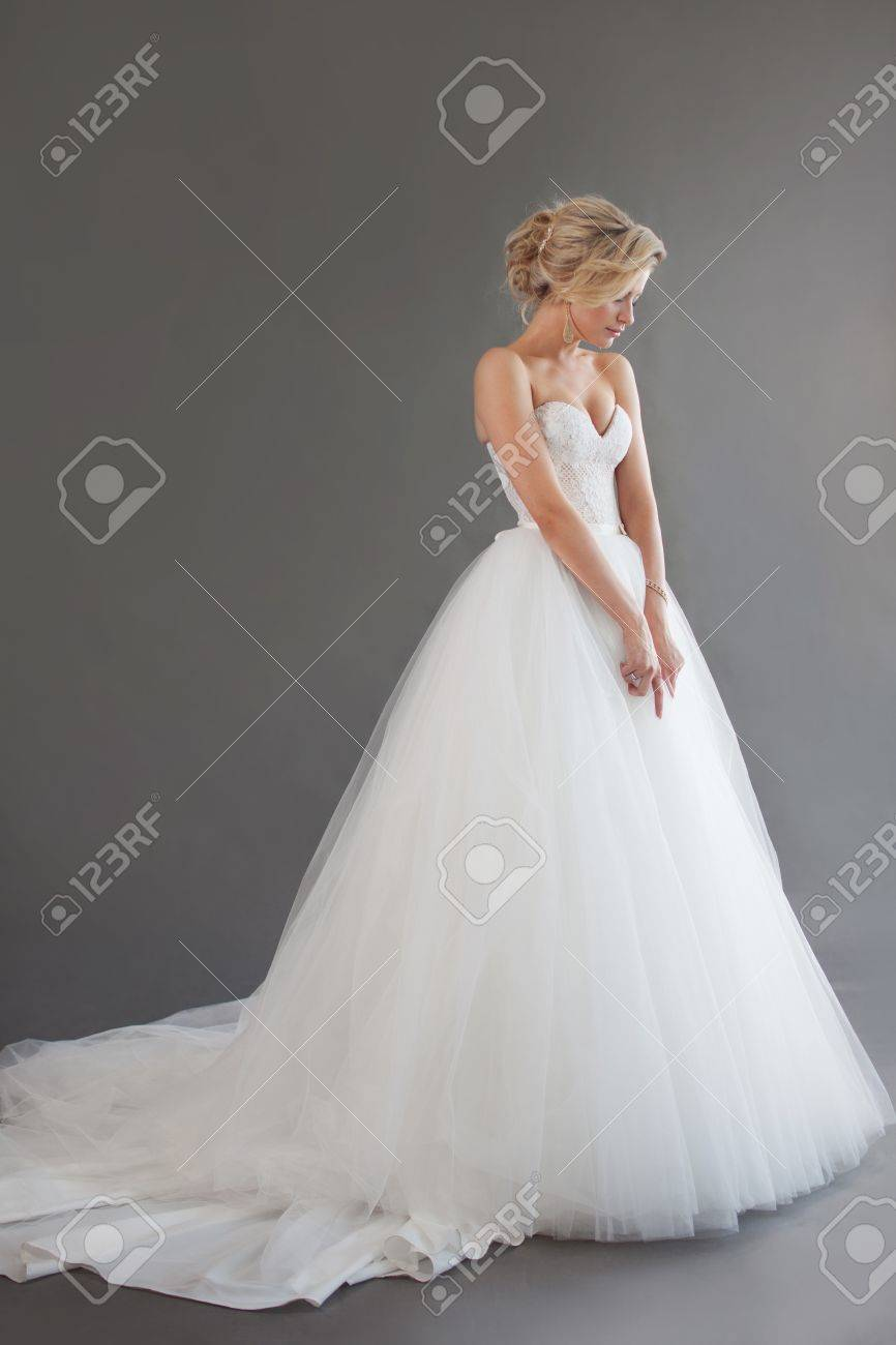 Charming Young Bride In Luxurious Wedding Dress. Pretty Girl.. Stock ...