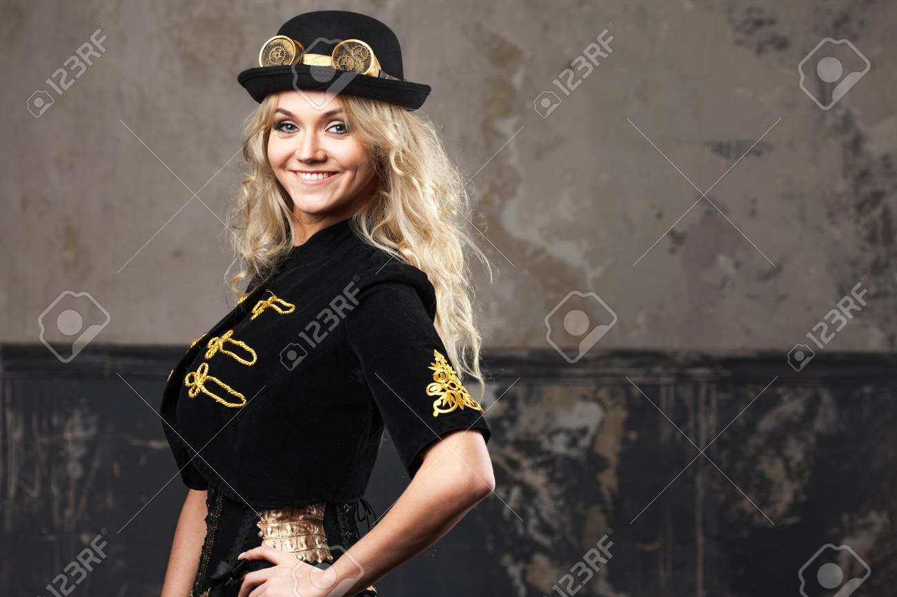 3b36c603277 Portrait of a beautiful steampunk woman hat-bowler hat over grunge  background. Stock Photo