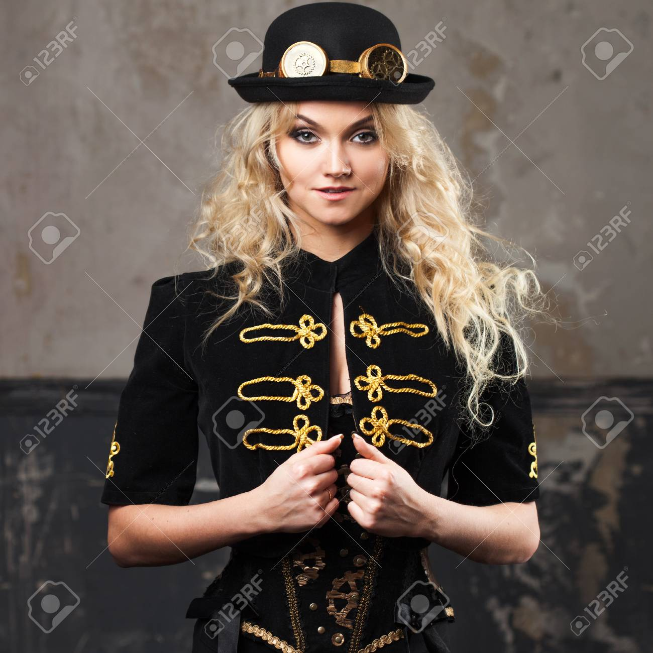 Portrait of a beautiful steampunk woman hat-bowler hat over grunge  background. Stock Photo 85241818bf90