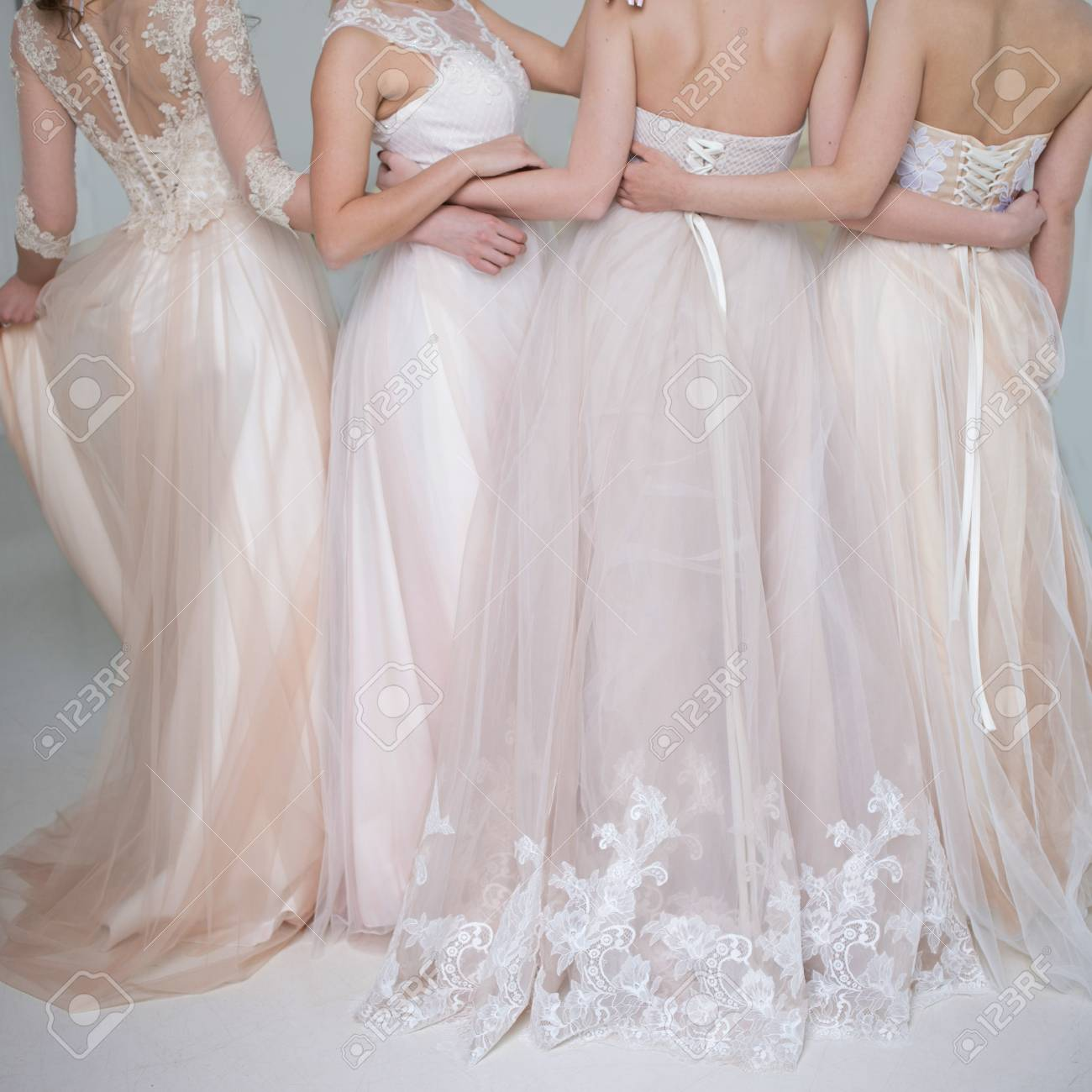 Four Beautiful Bridesmaid Dresses In Pastel Colors Are In Each