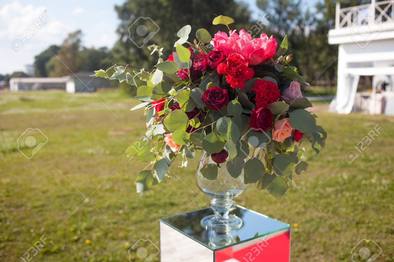 Wedding decor. Wedding registration outdoor. Luxury bouquets with red flowers - 85395107