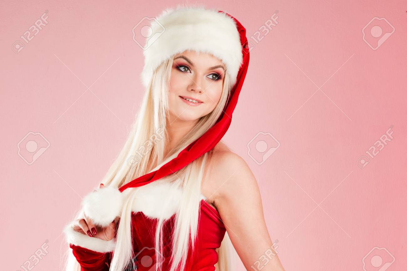 Christmas Outfit.Charming Blond Woman In Christmas Outfit Red Santa Suit With