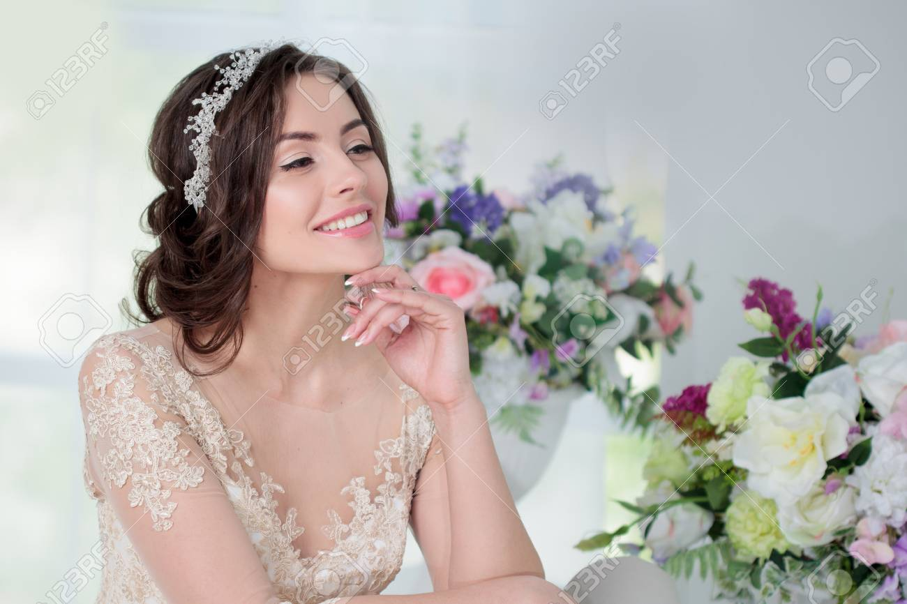 Portrait Of Beautiful Girl In A Luxurious Wedding Dress. Interior ...