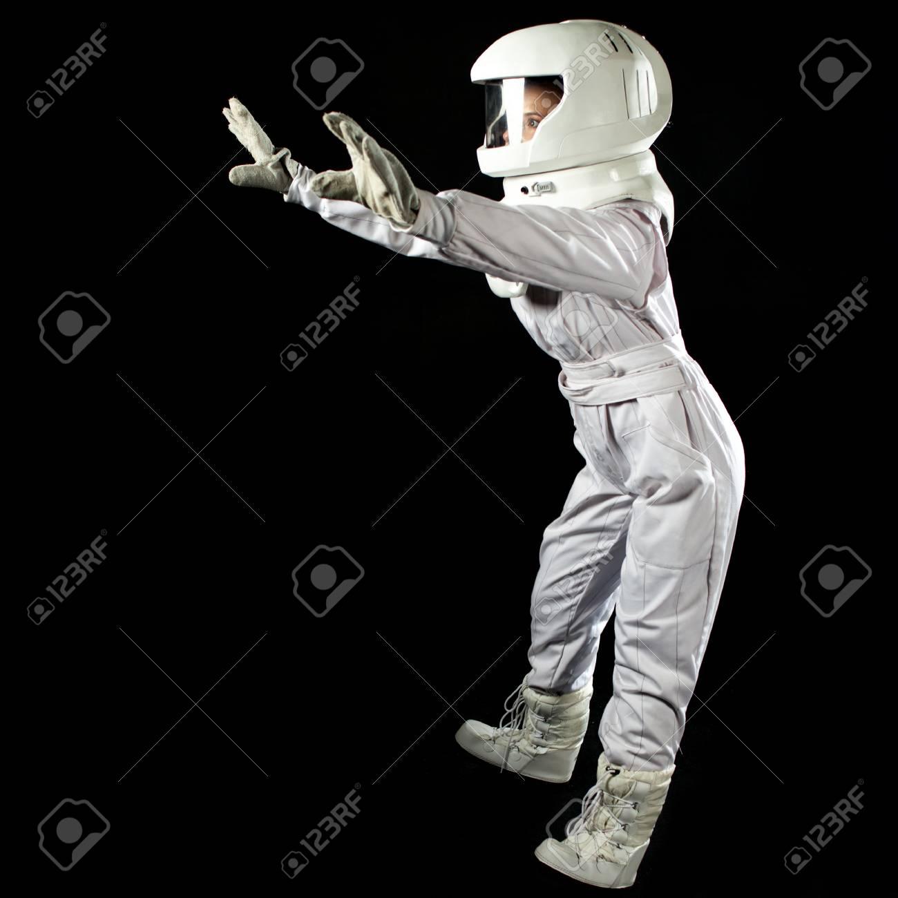 Astronaut in space, in zero gravity on black background  Man