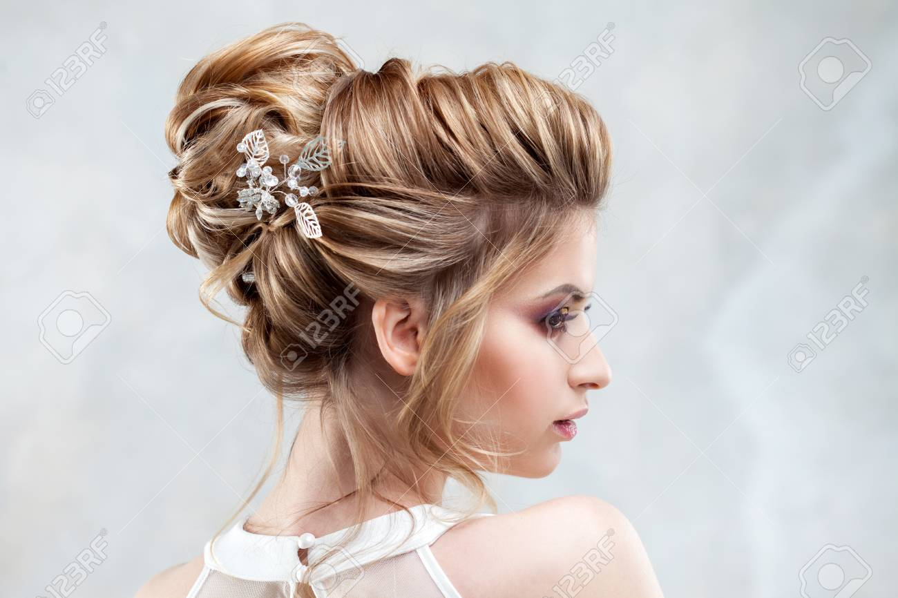 Young beautiful bride with an elegant high hairdo. Wedding hairstyle..