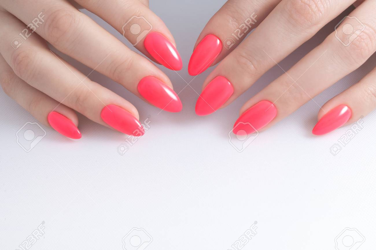 Women\'s Hands With Perfect Red Manicure. Nail Polish Red Coral ...