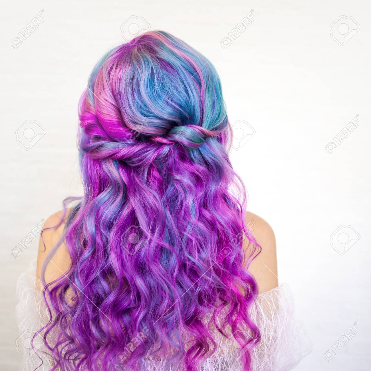 Back view of stylish youth girl with bright hair coloring, Ombre..