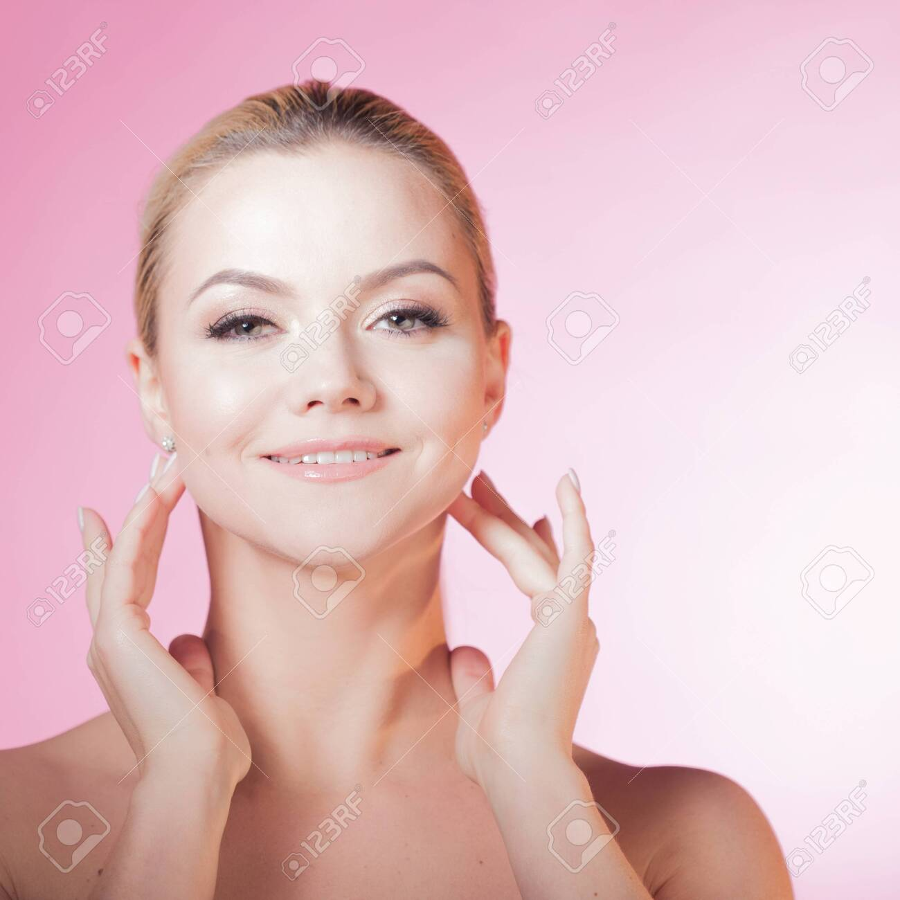 Face care and skin care, health and beauty concept, copy space. Happy young woman smiling, healthy skin and minimum makeup, naturalness and beauty. Charming blonde girl on pink background - 129383927