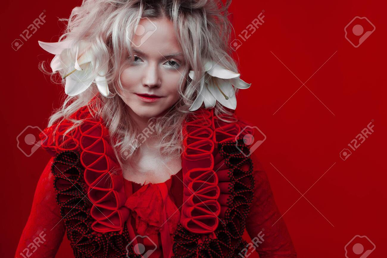 Shades Of Red Strange Attractive Blonde Woman With White Eyelashes Stock Photo Picture And Royalty Free Image Image 135651135