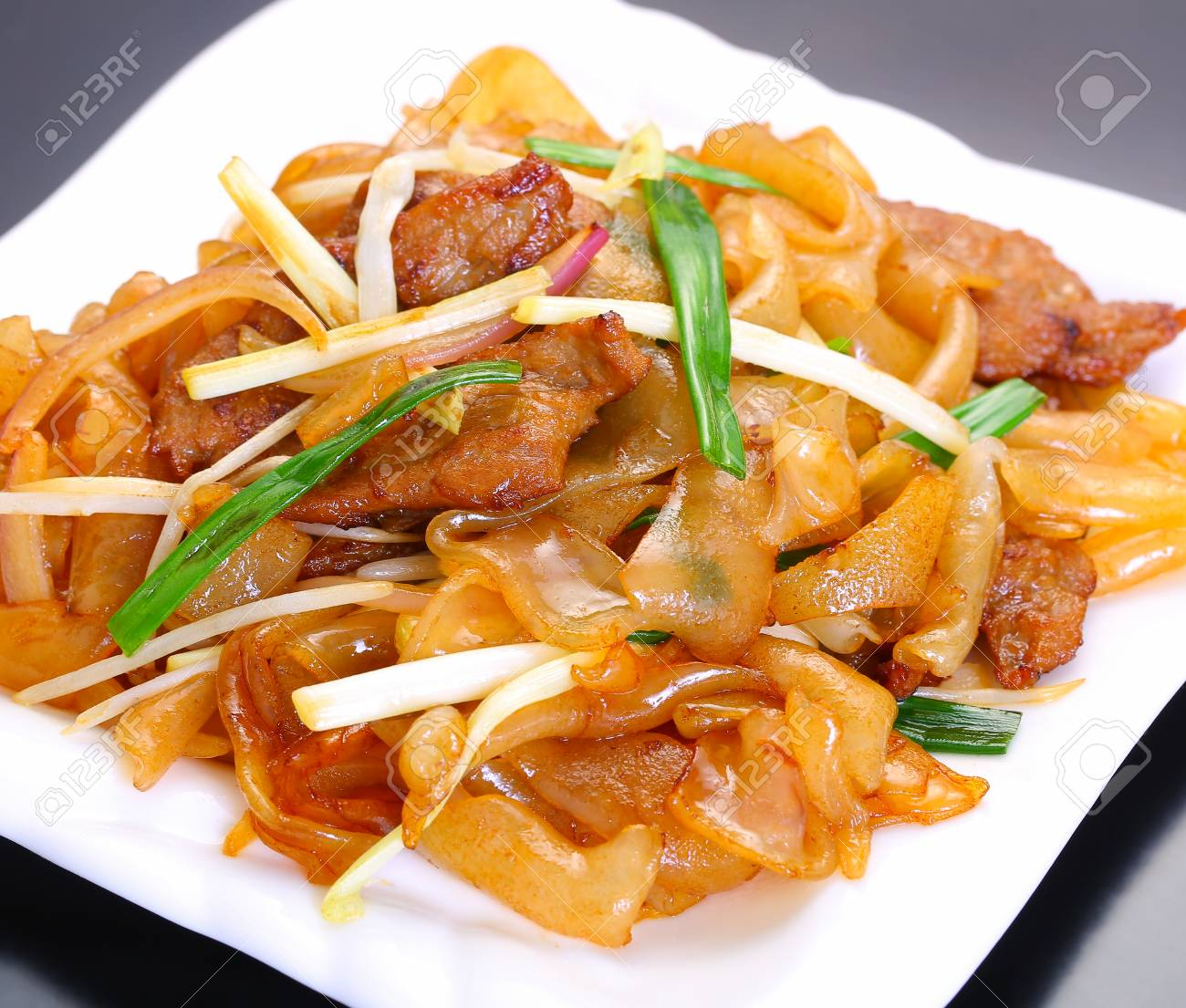 Stir Fried Rice Noodles With Beef Stock Photo Picture And Royalty Free Image Image 114820030