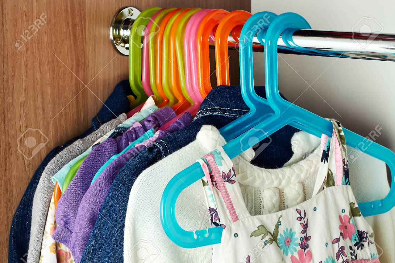 wardrobe with baby сlothes on  hangers Stock Photo - 24694268