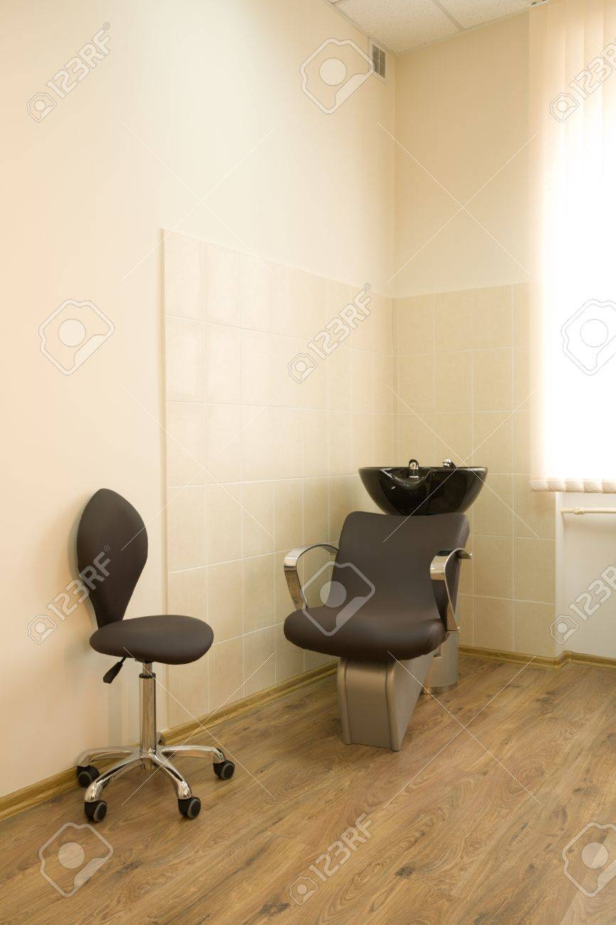 Chair-washing and chair barber in a barbershop. Stock Photo - 10298829